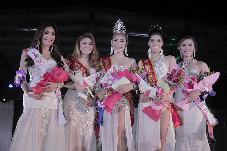 The crowning night of winners (center) Exur Pastor Lañuwa of Davao City was crowned as the Goddess of the Night, Gay Summit Queen 2015 followed by (2nd from right) Kim Marie Villagalano 1st Runner Up; (4th from right) Jameico Niño Similatan 2rd Runner Up; (5th from right) Angel Montenegro 3rd Runner Up and (1st from right) Christian Nebrada 4th Runner Up during the pageant night at Tagum Trade and Cultural Center Pavillon last July 25, 2015. Photo by Leo Timogan/CIO Tagum
