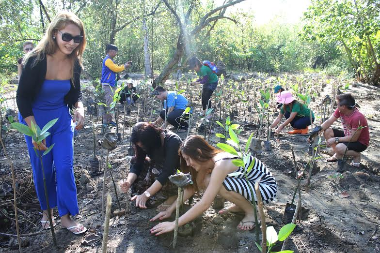 One of the activities done by the candidates of Goddess of the Night, Gay Summit Queen 2015 was Mangrove Tree Planting at Brgy. Madaum, Tagum City. Photo by Glieza Delgado/CIO Tagum