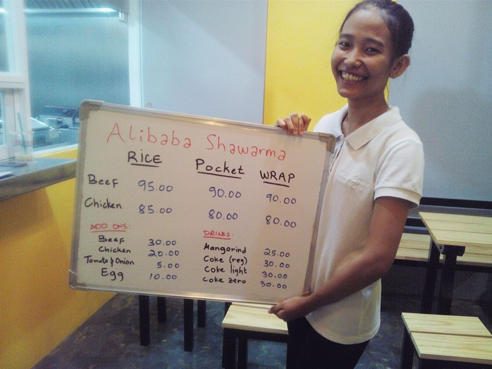 Their most bubbly crew showing us the temporary menu. Keep up the energy ate! Your personality adds brightness to Alibaba Shawarma. Great Job!